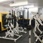 Inside Squats Gym: Power cage, row machine and behind neck press